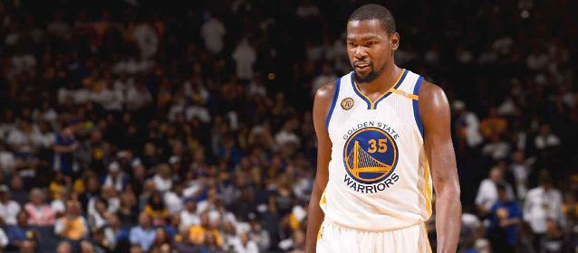"Kevin Durant scored a team-high 27 points in his Golden State debut, but the host Warriors lost in blowout fashion to the Spurs, prompting Draymond Green to quip, ""I'm sure the story tomorrow will be, 'KD broke up the chemistry and we can't win with KD.'"" Noah Graham/Getty Images"